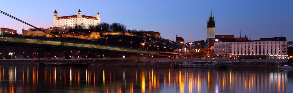 Bratislava Castle And Novy Bridge At Sunset With Reflection